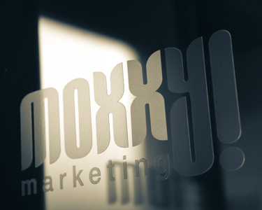 design element - logo on Moxxy office door.